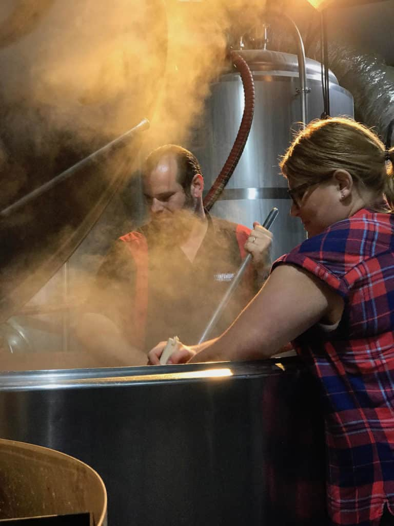 Pictire of BOSxAUS Collaboration Oyster Stout Samuel Adams Infamous Brewing Jennifer and Josh